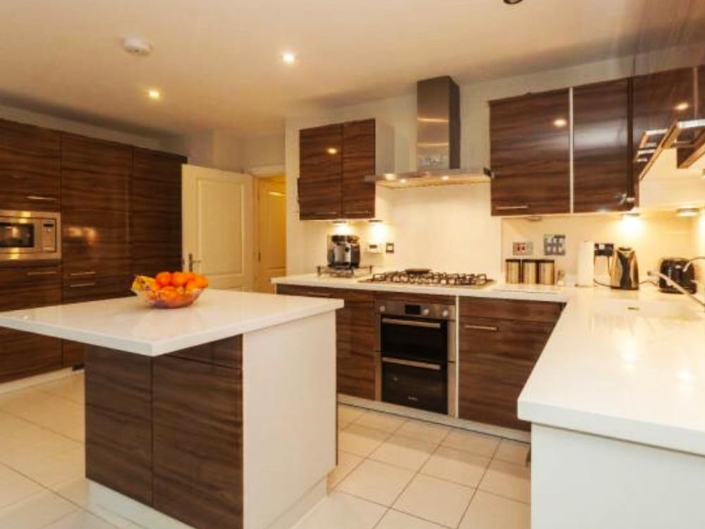 L-Shaped Alno Island Kitchen with Corian Worktops & Appliances